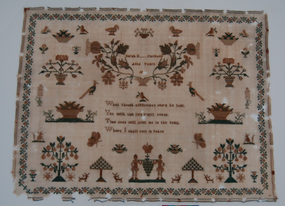 Early 19th century embroidery sampler, by Sarah E... Cuckow.  The memento moro verse reads 'What thou's afflictions storm be long/ Yet with this life t'will cease/ Time soon will bring me to the tomb/ Where I shall rest in peace' - Material inspiration for 'Time soon will bring me to the tomb' - Image provided by Luba Nurse