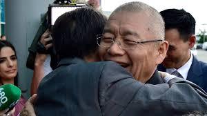 two men hugging.jpg