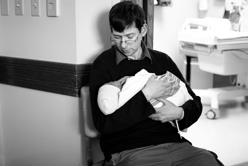 dad holding baby-pittsburgh mercy-birth photography