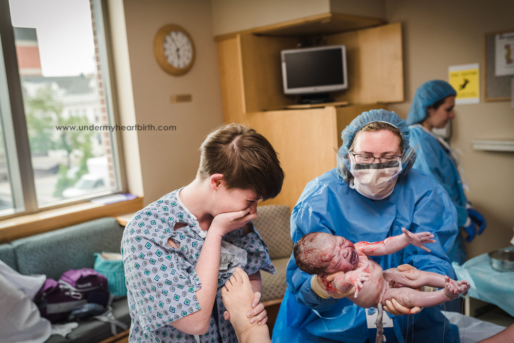 baby being born birth photography