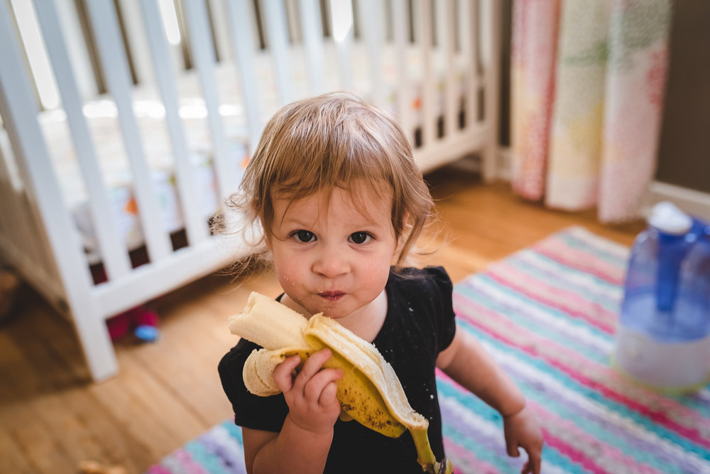 toddler eating banana