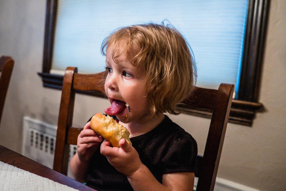 licking donuts