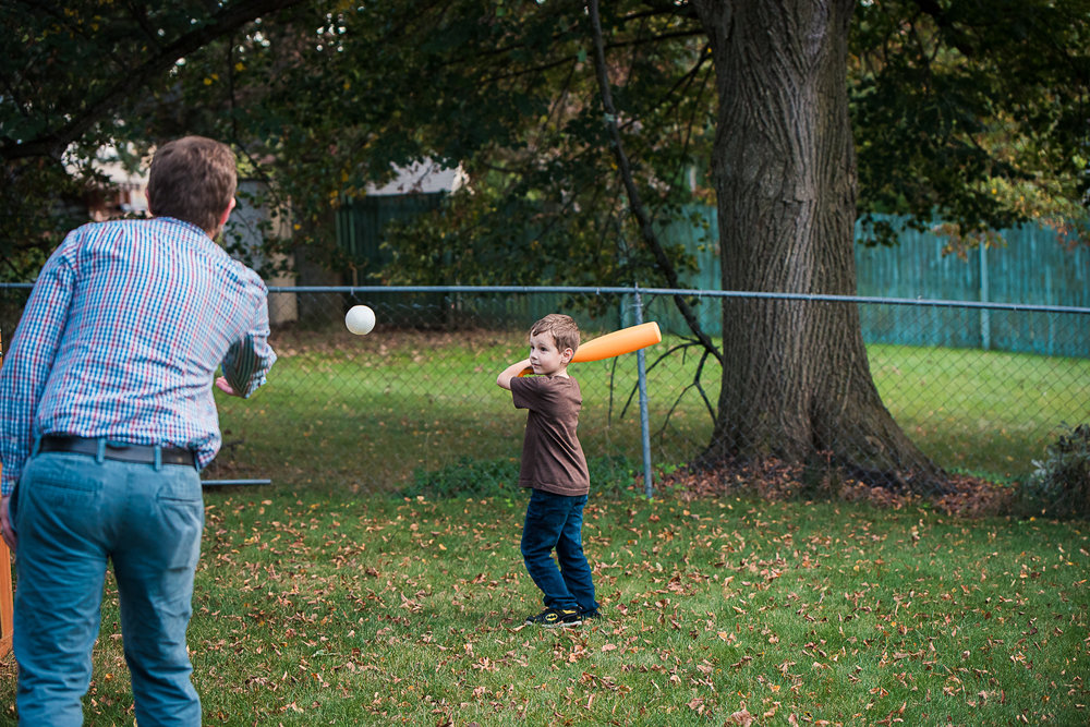dad and son playing baseball
