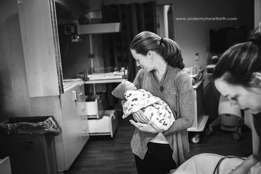 mother holding her son after surrogate delivery