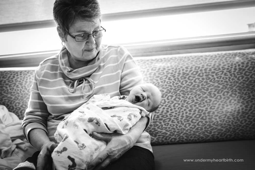 Grandma holding newborn