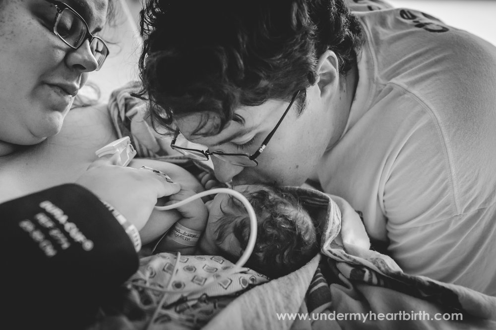 father kissing baby pittsburgh birth photography