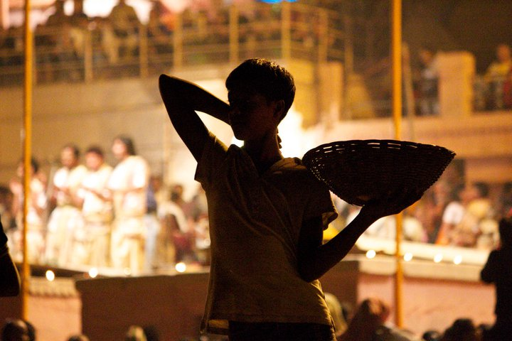 Boy selling candles at the Arti celebration on the banks of the Ganges, Varanasi, India