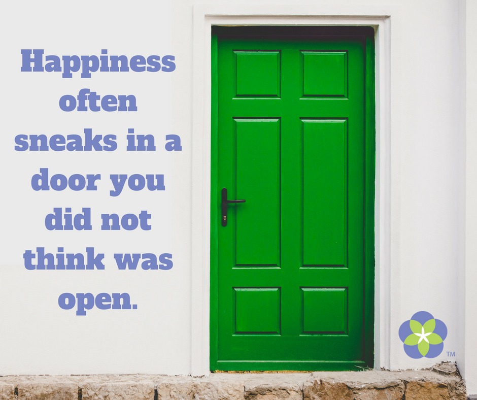 Happiness often sneaks in a door you did not think was open. (1).png