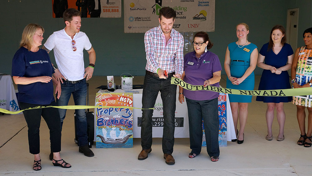 JD and Jonathan Scott from HGTV's Property Brothers help Celebrate by cutting a ceremonial ribbon at the new TSI facility.