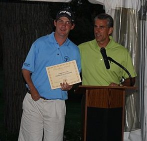 Vince Biser receives his award from Michael O. Brooks.