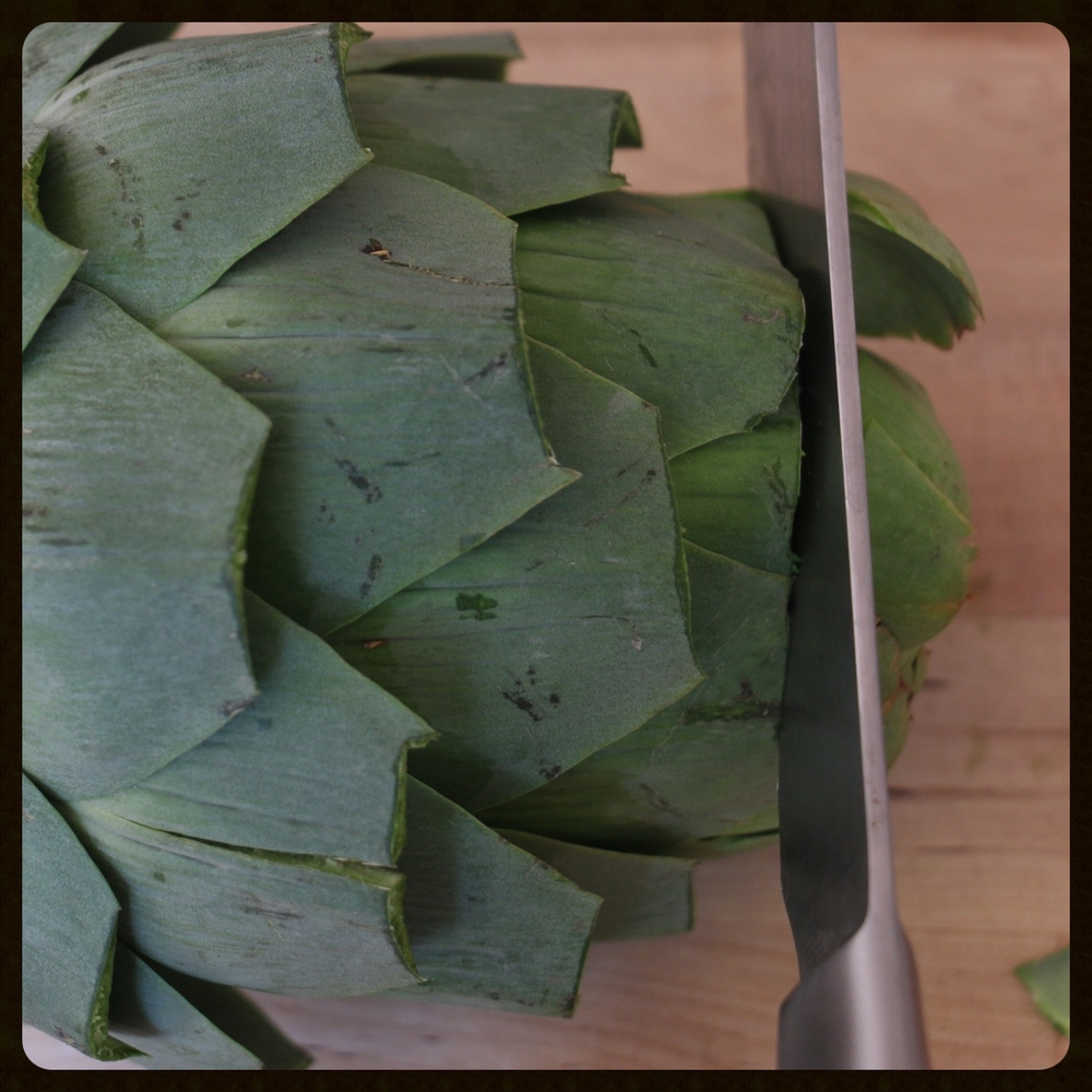 You want to chop the top off so you can separate the leaves and get the garlic inside.