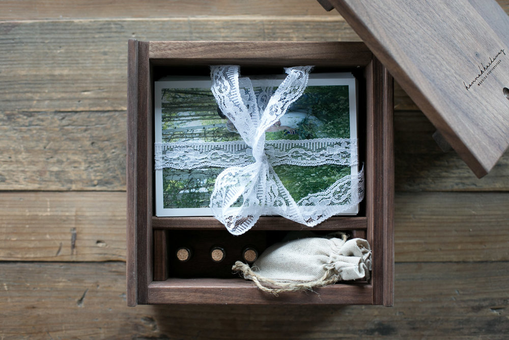 Level One packages include an oil rubbed walnut proof box handmade by Amish craftsmen in the Midwest. Boxes hold a studio selection of approximately 200 4x6 Professional Proof Prints of the highlights from your day. There is also a space in the box to store your USB drive, as well as three small vials to preserve any keepsakes from your day (the perfume and cologne you both wore, dirt from your ceremony site, crushed flowers from your bouquet or boutonniere, a little (mini!) note, or anything else you would like...)
