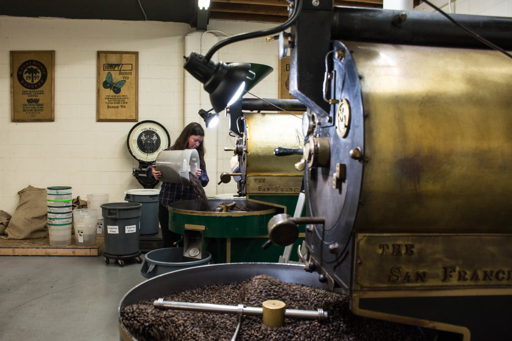Stephanie adding beans to the roaster