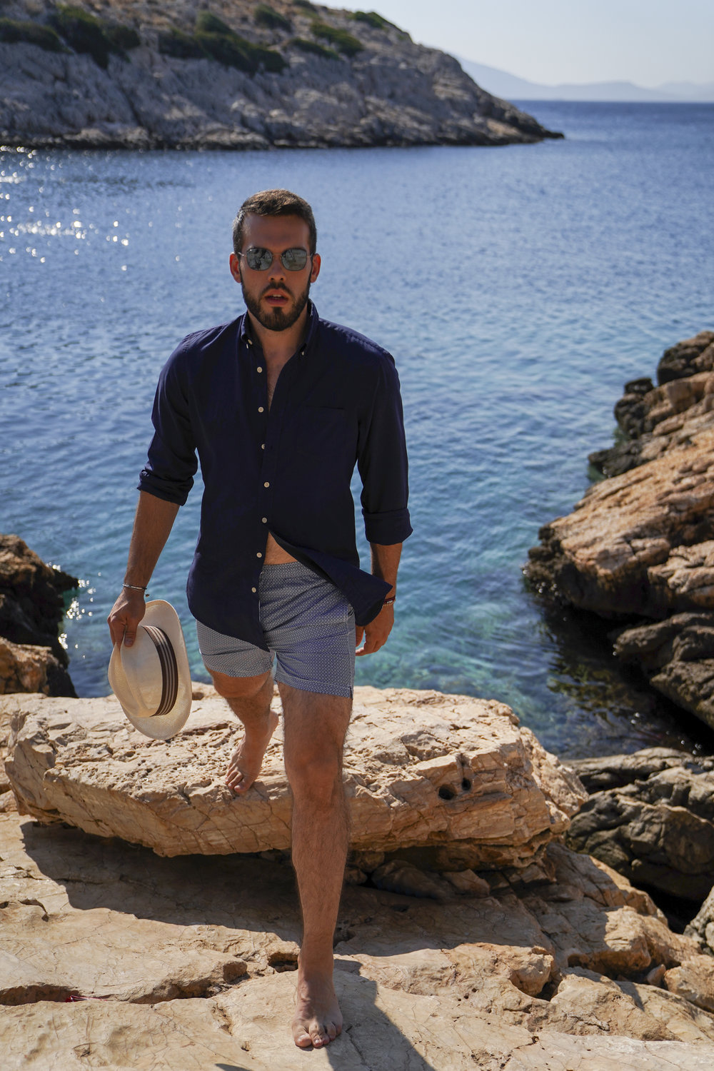 Swimsuit & Shirt: Hackett London / Sunglasses: Tomas Maier