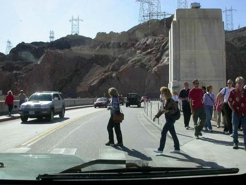 Narrow lanes and pedestrian traffic make crossing Hoover Dam go slowly
