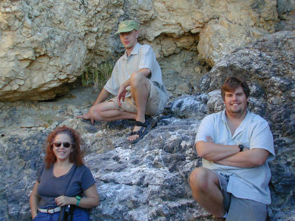 Maria, Kendal, and Mike pose on the rocks near Cow Camp