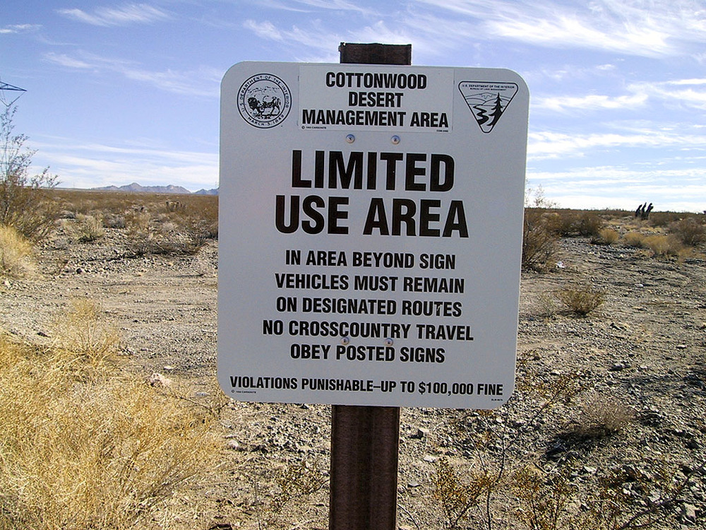 Cottonwood Desert Management Area  Limited Use Area  In area beyond sign vehicles must remain on designated routes no cross-country travel obey posted signs