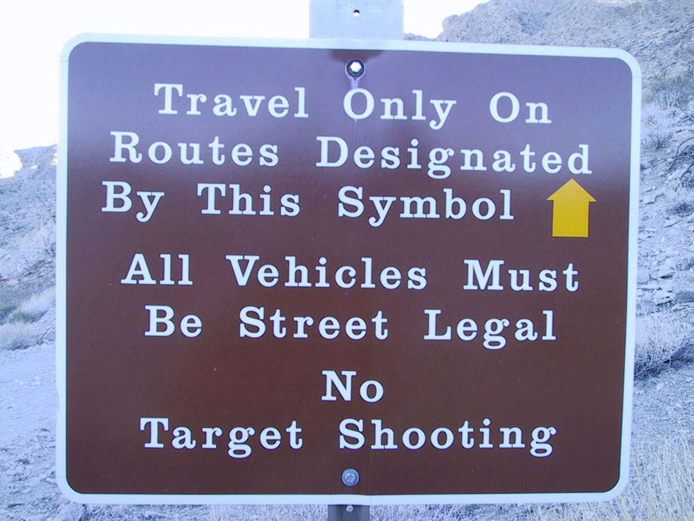 Travel only on routes designated by this symbol. All vehicles must be street legal. No target shooting.
