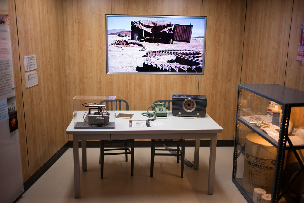 Exhibit covering the Nevada Test Site and Army Gunnery School.