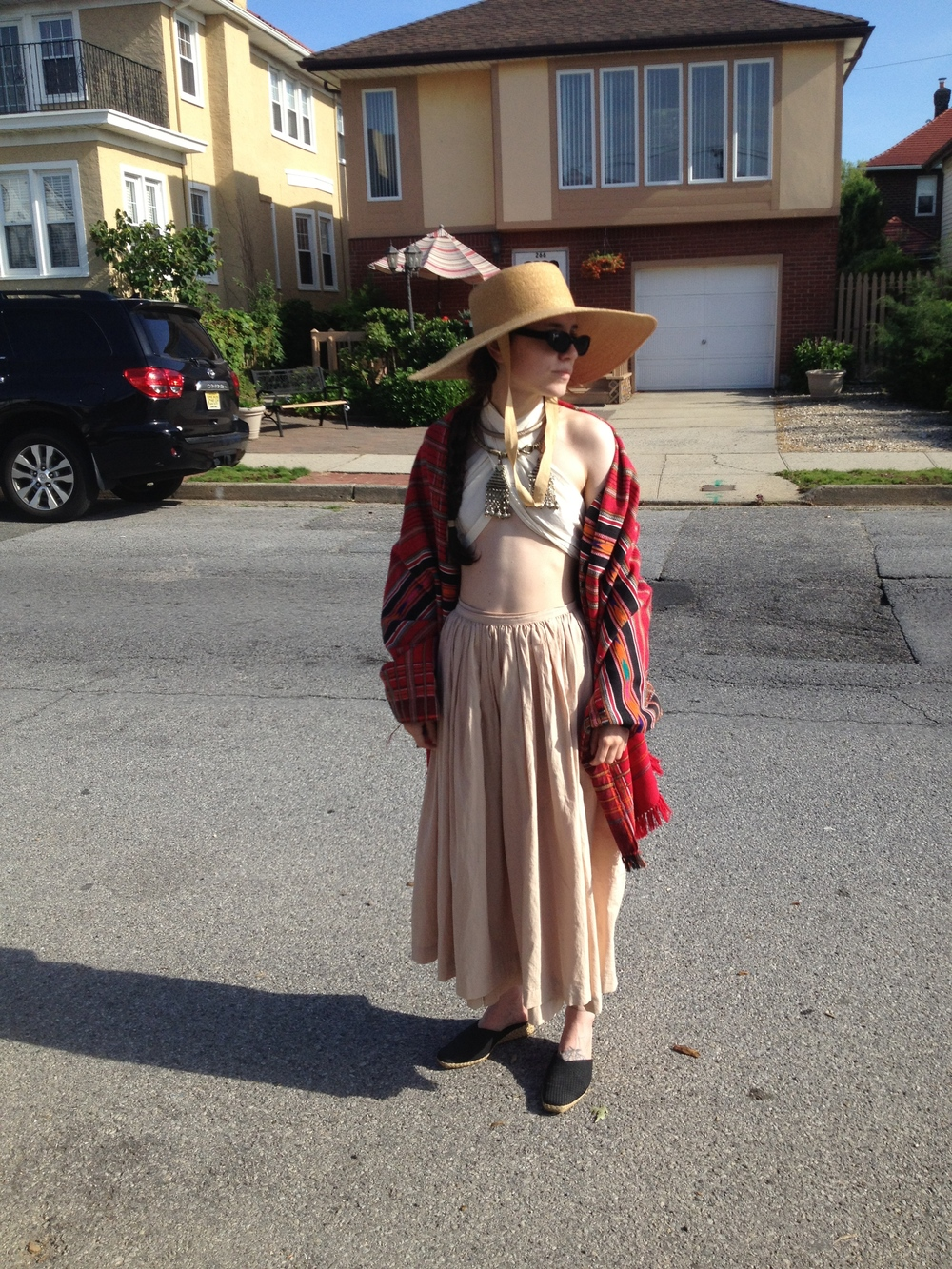 On a day trip to Long Beach wearing a straw hat and woven blanket from Beacons Closet. I made the wrap skirt and muslin bandeau top.