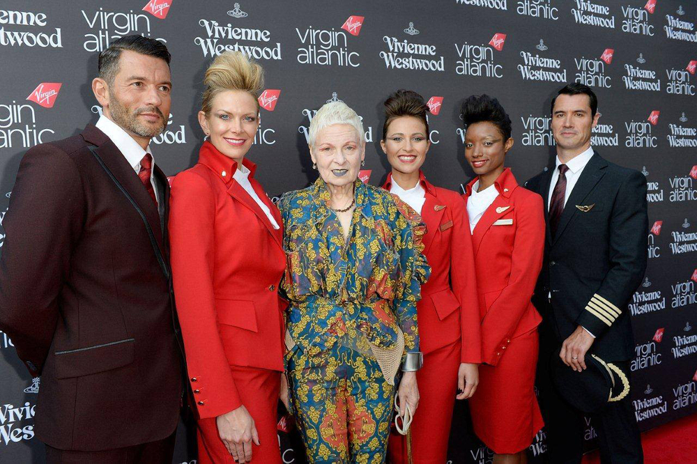 Vivienne Westwood poses with models wearing her new uniform designs