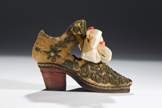 French or English mid--17th century. Red heeled boy's shoe, buff sueded with stacked leather 'polony' heel.Collection of the Bata Shoe Museum. Image © 2015 Bata Shoe Museum, Toronto, Canada. Photo by Ron Wood