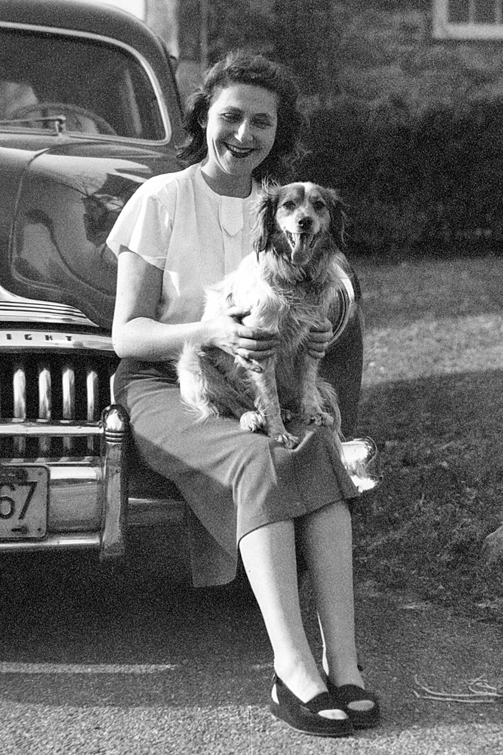 Anne and dog on Eli's Buick Eight