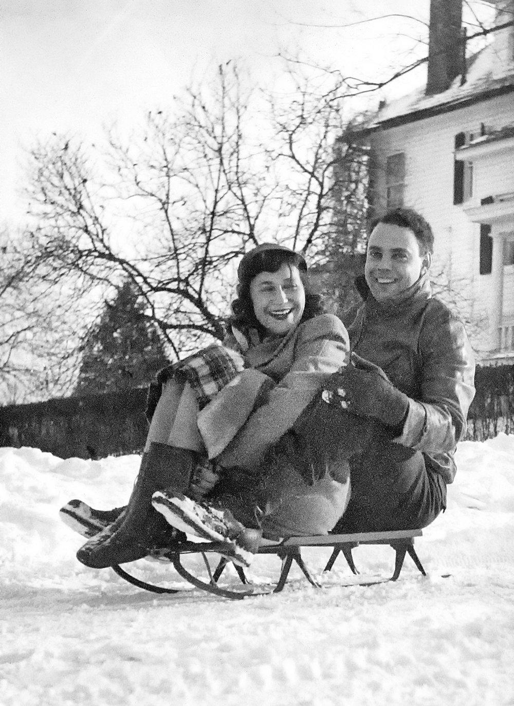 Anne and Doug sledding in Mt. Washington, Winter of 1947-48