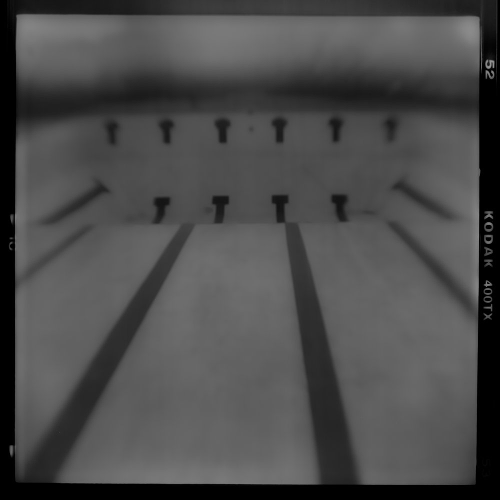 Pinhole black and white photograph, David McCleery, Summer Abandoned, Drained swimming pool, pinhole photography, nebraska photography
