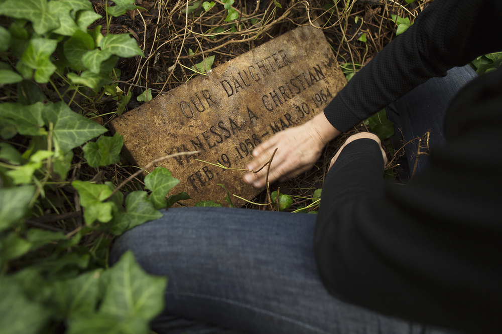 Erin wipes dirt from Vanessa Christian grave marker. East End Cemetery, Henrico County, Virginia, October 2015. Photo: ©BP