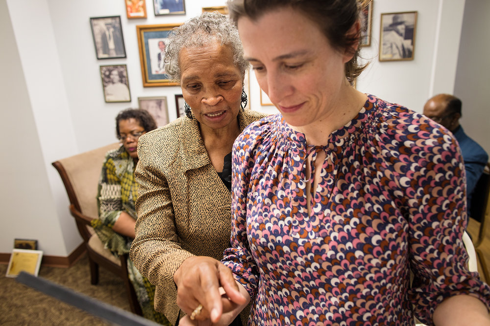 Ann Jones and Erin discuss photos to be rehung on the walls of Mt. Pilgrim Baptist Church's newly constructed wing, Williamsburg, VA, April 10, 2016