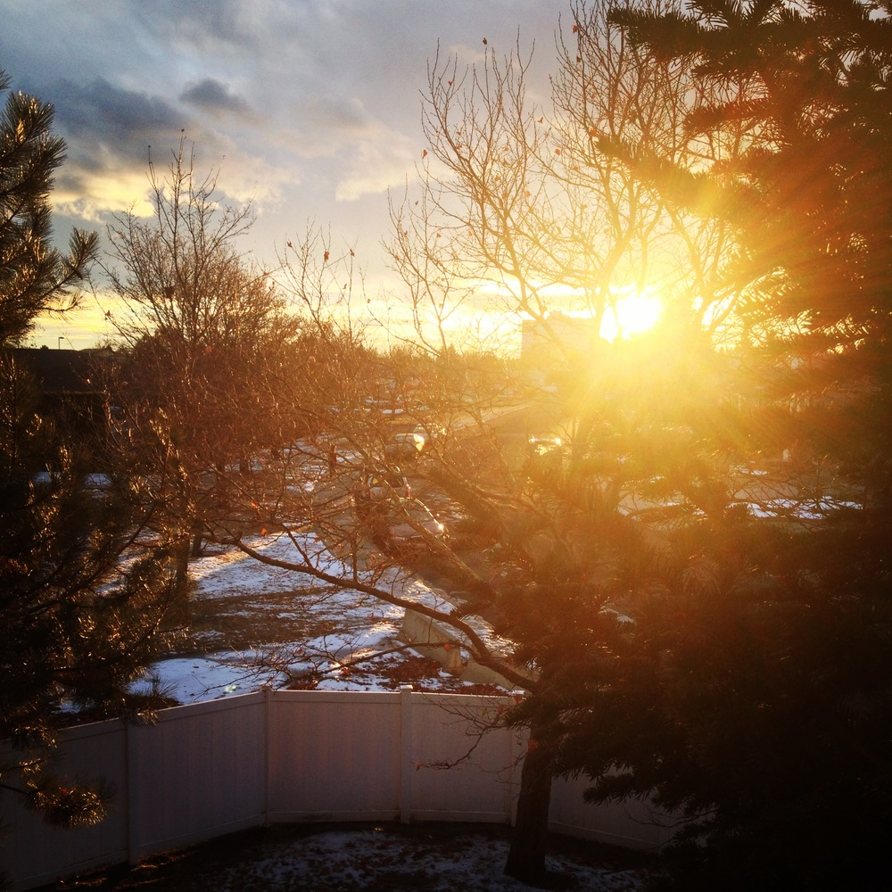 A sunset from the view of my porch; I love the feeling of warm sunshine blaring in when it's still winter.