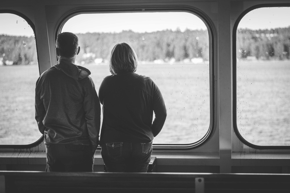 A couple watching outside the ferry windows