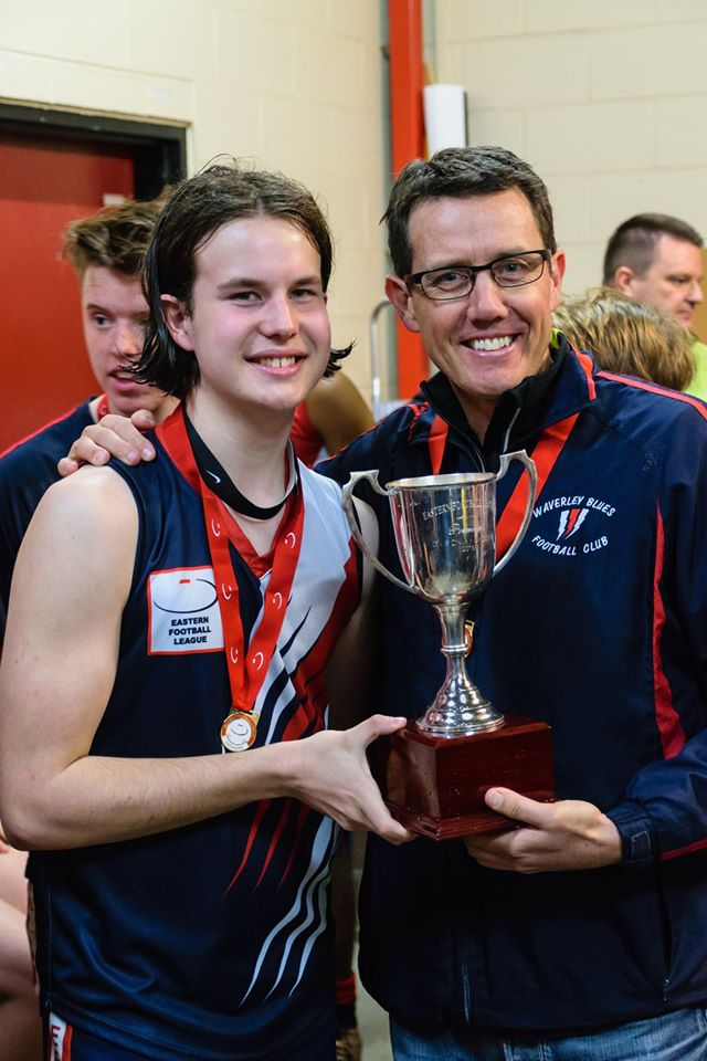 Bryce and his son Liam holding the 2017 Under 17A Premiership Cup