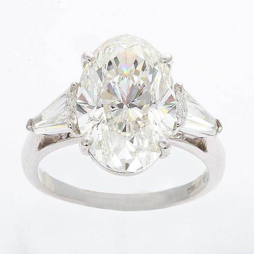 a stunning 5 32 ct g si1 oval cut diamond platinum ring with kites