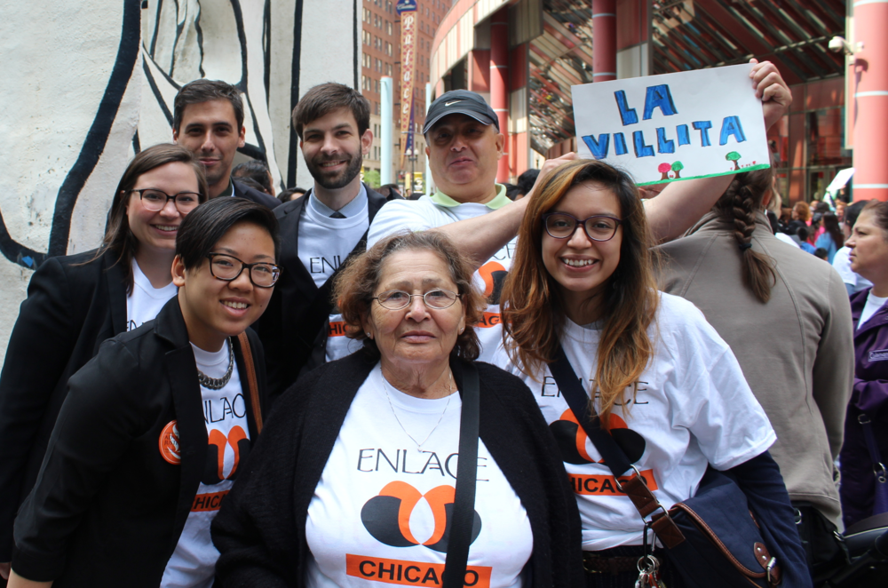 "Two clients who were active in civil disobedience in their home countries joined staff and interns from the Enlace Community Activism Law Clinic! Clients stood up for residents of ""La Villita,"" which means Little Village in Spanish."