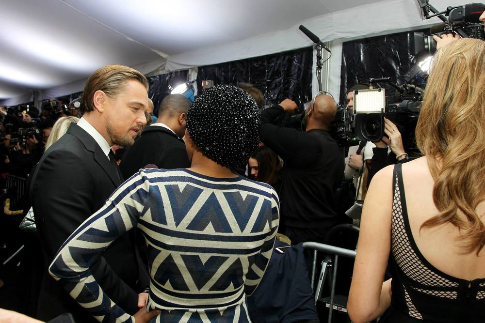 behind-the-scenes-shot-of-leonardo-dicaprio-interview-on-the-red-carpet-at-the-new-york-city-premiere-of-the-wolf-of-wall-street-red-granite-pictures-red-granite-international.jpg