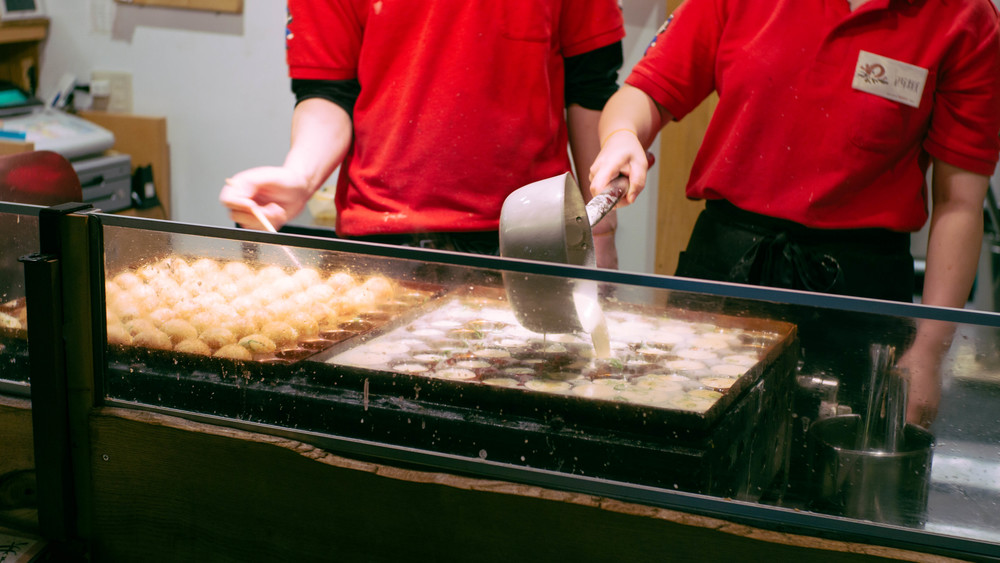 Our first day, we woke up after a long nap and explored the streets of Kyoto at night in search of anything that was still open. We stumbled by a place serving takoyaki.
