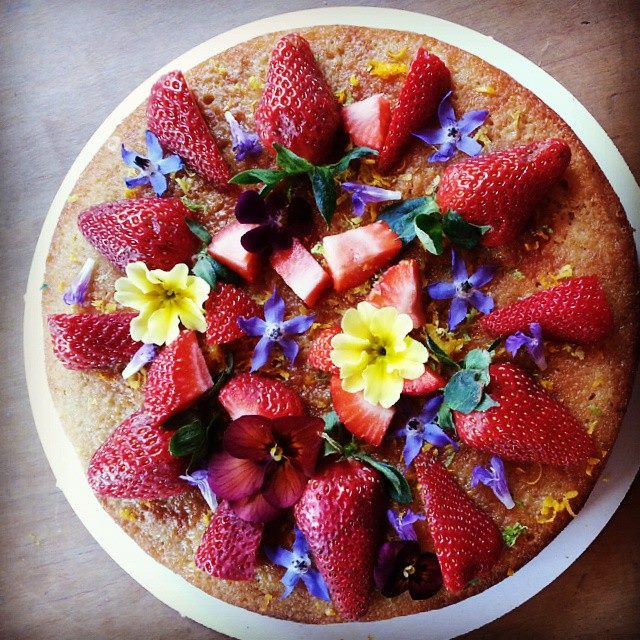 Lime Riesling cake topped with seasonal fruit and edible flowers $60