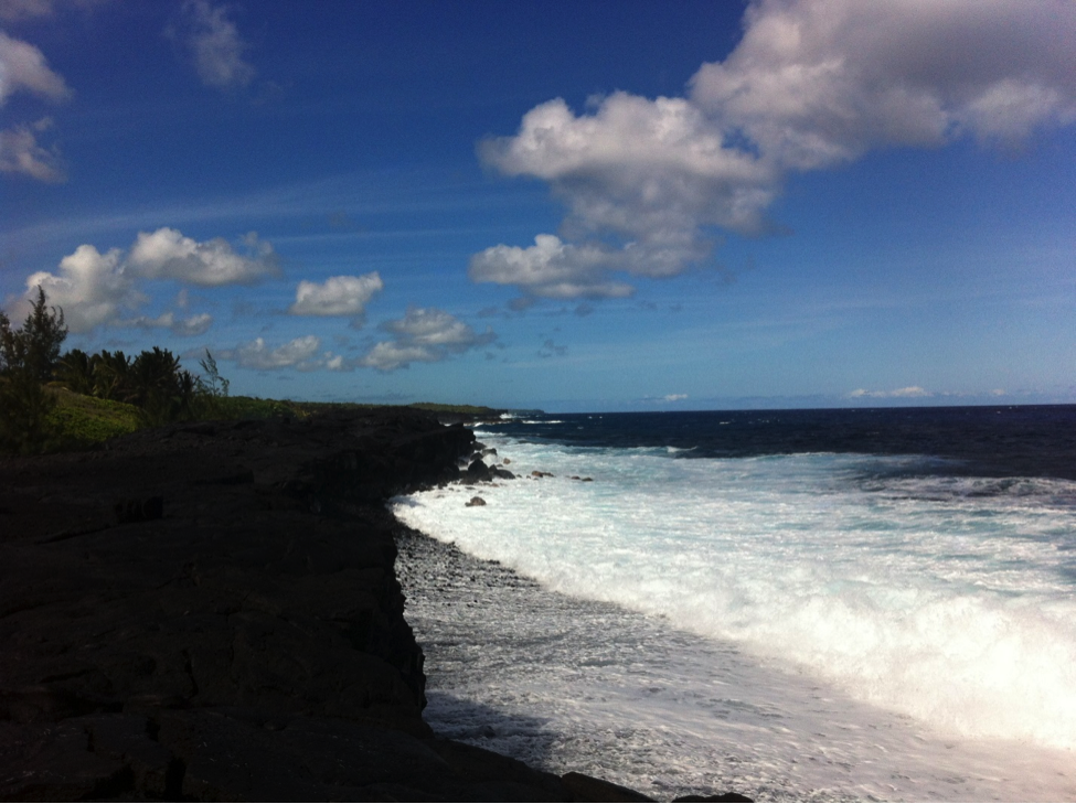 Kaimu 2014; below the lava cliffs, new black sand is created by the crashing waves