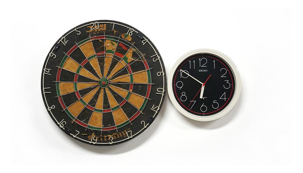 Agustina Woodgate, Hemispheres Destiny, Found dart board, clock, rotation motor, 15″ x 35″ x 3″, 2013