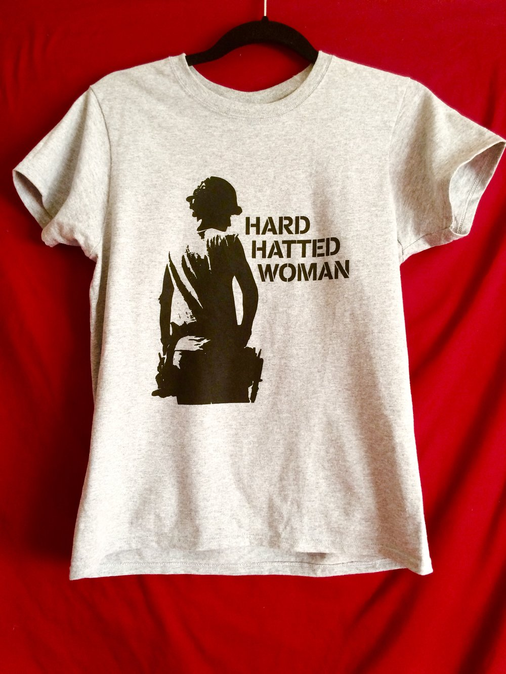 Are you a hard hatted woman at heart? Let the world know it! - Donate $75 or more today and get your FREE TEE and matching hardhat sticker.