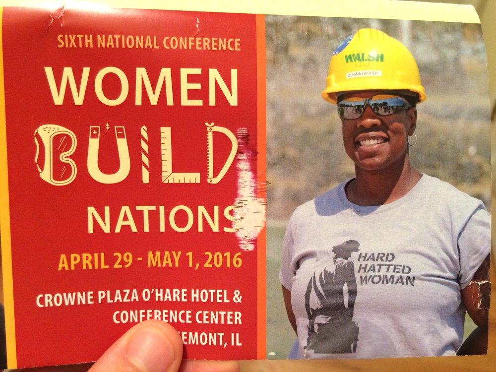 The official postcard announcing the 2016 Women Build Nations conference, complete with photo of a Hard Hatted Woman supporter wearing our t-shirt!