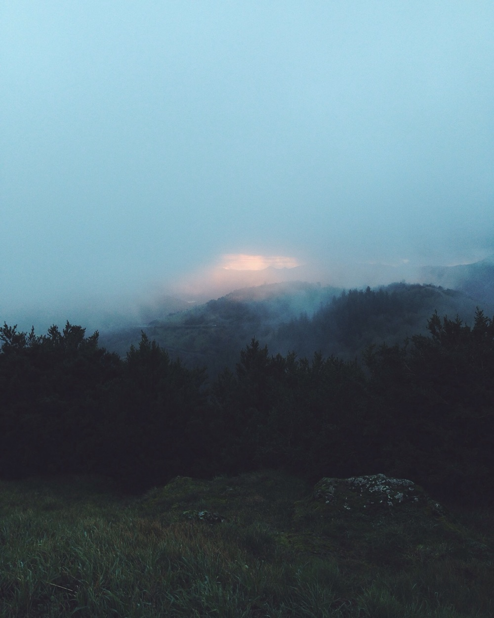 sunrise in foggy mountains