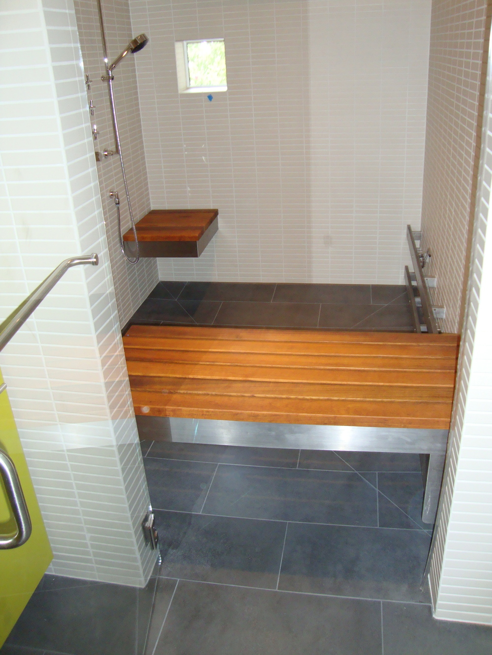 Handicap accessible shower bench upper story design for How to build a wheelchair accessible shower