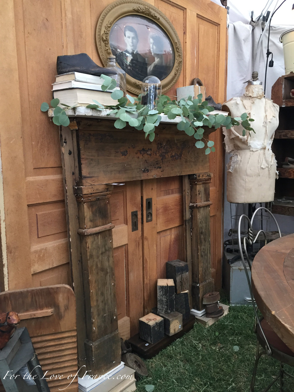 Vintage display with wooden pocket doors and fireplace surround