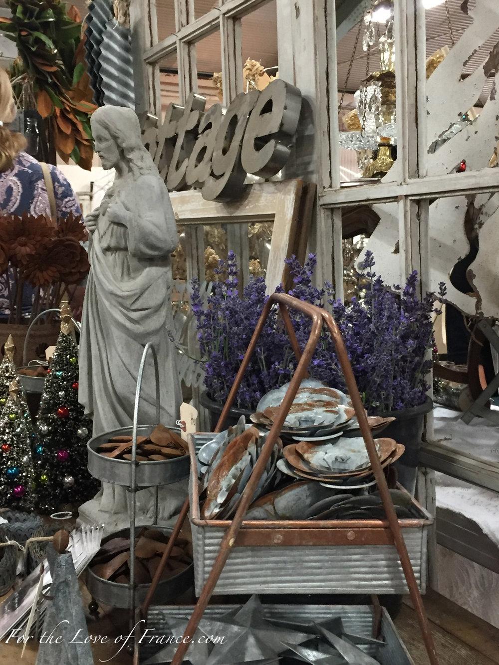 Sacred heart of Jesus cement statue in vintage exhibit