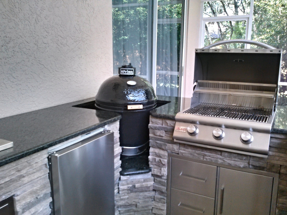 "This picture has the  Blaze 25"" 3-Burner Gas Grill , and  Primo Smoker."