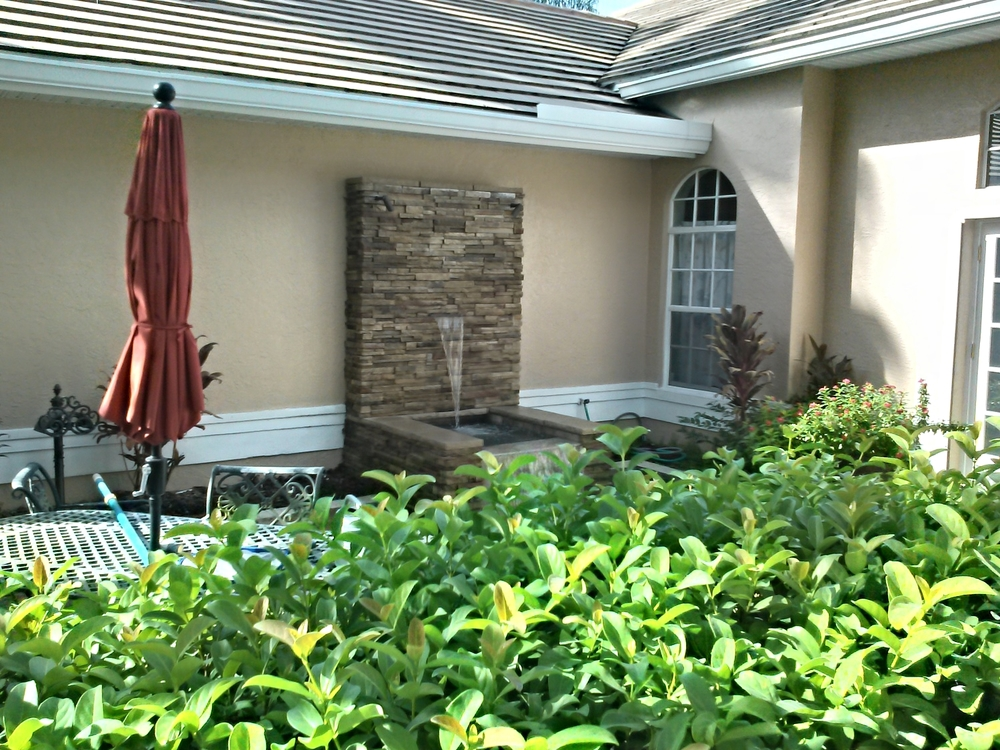 Clark Outdoor Kitchen & Water Feature - Behind Bush Water Feature