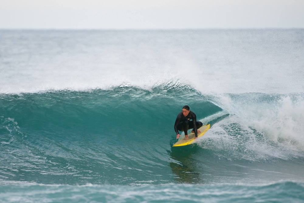 Cruising through the pocket on an old school single fin.   Photo: Richard Mattison